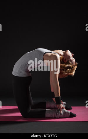 woman exercising ustrasana camel pose yoga silhouette