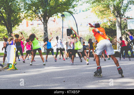 Zamora, Spain - September 02, 2017: People perform an aerobic session outdoors in an urban park. Cycle Against Cancer. - Stock Photo