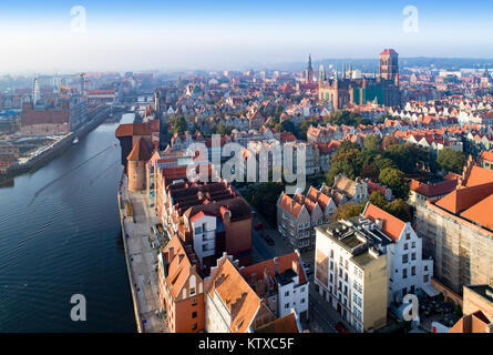 Gdansk old city in Poland. Skyline with the oldest medieval port crane (Zuraw) in Europe, St Mary church, Town hall - Stock Photo