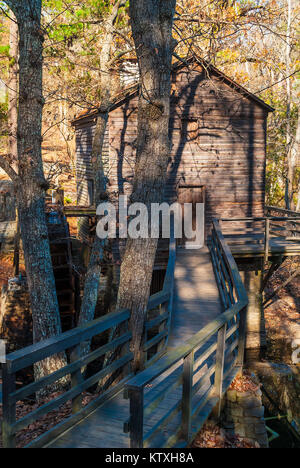 Grist Mill and the wooden bridge in the Stone Mountain Park in sunny autumn day, Georgia, USA - Stock Photo