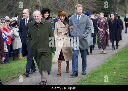 Picture dated December 25th 2017 shows The Duke and Duchess of Cambridge, Meghan Markle and Prince Harry at the - Stock Photo