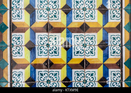 Brightly coloured, Portuguese azulejo ceramic tiles, decorate the external walls of a building in Lisbon, Portugal. - Stock Photo