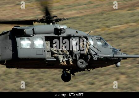 A U.S. Air Force HH-60 Pave Hawk helicopter flies over the Orchard Combat Training Center September 16, 2009 near - Stock Photo