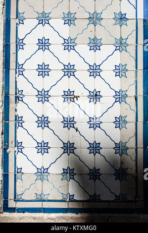 Portuguese azulejo ceramic tiles with a floral pattern, decorate the external walls of a building in Lisbon, Portugal. - Stock Photo