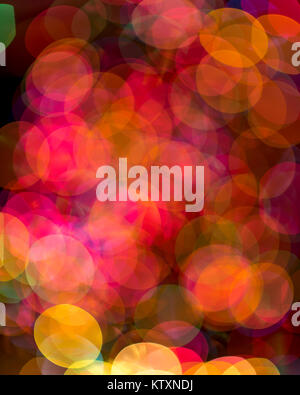 Predominantly red and yellow overlapping circles of light created by a severe out of focus capture. - Stock Photo