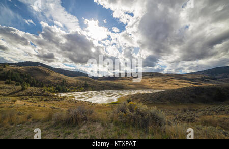 Cloudy day at Spotted Lake in British Columbia, Canada - Stock Photo