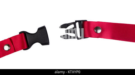 Open black plastic side release buckle with red woven strap attached - Stock Photo