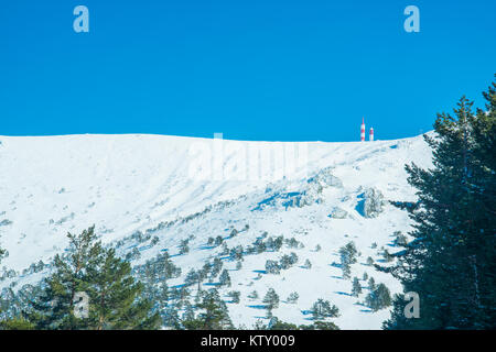 Snow covered Bola del Mundo mountain. Navacerrada, Madrid province, Spain. - Stock Photo
