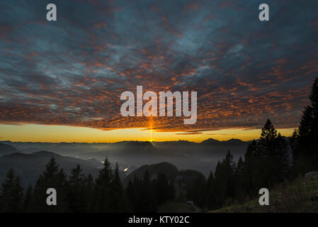 Glowing clouds at sunset over Pendling, Inn valley, Zillertal range, Rofan Mountains and Karwendel, Tyrol, Austria - Stock Photo
