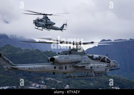U.S. Marine Corps AH-1Z Viper attack helicopters fly over the Marine Corps Air Station Kaneohe Bay December 21, - Stock Photo