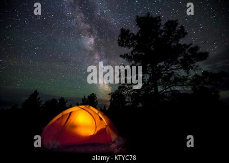 Stars in the night sky over a camping tent near the Upper Missouri Wild and Scenic River at the Upper Missouri River - Stock Photo
