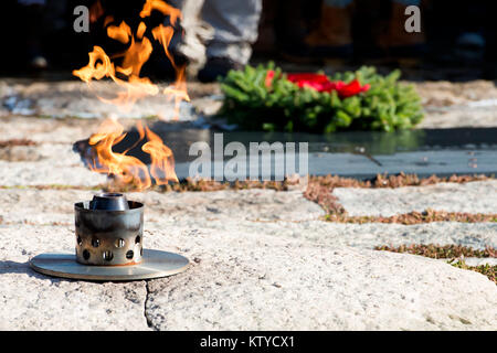 A torch burns in front of the U.S. President John F. Kennedy gravesite at the Arlington National Cemetery during - Stock Photo