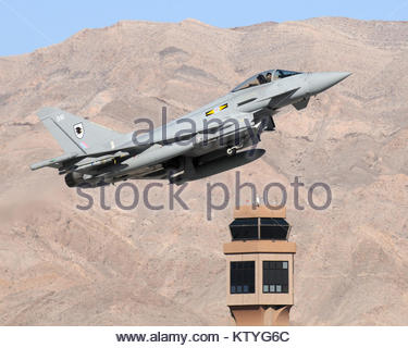 Pictured is a Royal Air Force Typhoon pilot in front of ...