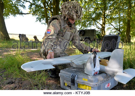 Soldiers from the Royal Artillery assemble and fly the Desert Hawk 3 UAS (Unmanned Air System) over Salisbury Plain - Stock Photo