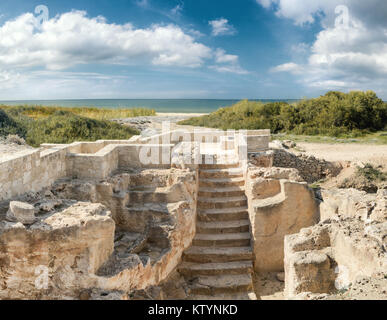 Paphos archaeological park at Kato Pafos in Cyprus, panoramic image of ancient ruins and the seaside - Stock Photo