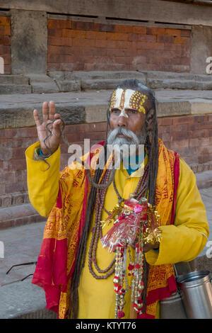 Portrait of Sadhu holy man in Durbar Square, Kathmandu, Nepal - Stock Photo