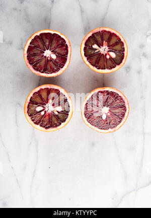 Fresh Blood Oranges on Marble Table - Stock Photo