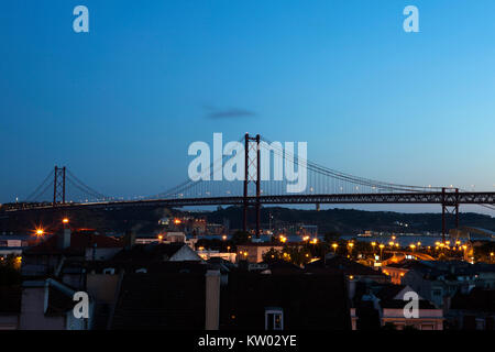 View of the 25 April Bridge (Ponte 25 de Abril) in Lisbon, Portugal. The suspension bridge spans the River Tagus. - Stock Photo