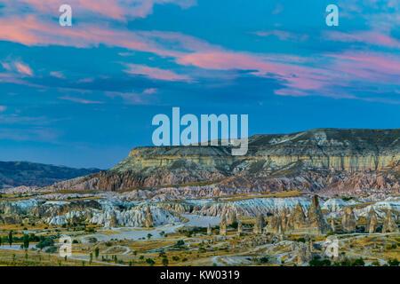 Fairy chimneys, badlands and mesa, near Goreme, Cappadocia, Turkey - Stock Photo