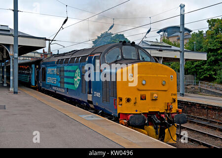A Direct Rail Services class 37 diesel electric locomotive departing Norwich railway station with a train to Great - Stock Photo