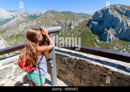 Velebit mountain in Paklenica national park in Croatia, girl looking at mountains panorama - Stock Photo