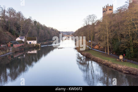 Durham, England, UK - January 29, 2017: University rowing crews train on the River Wear below the west face and - Stock Photo