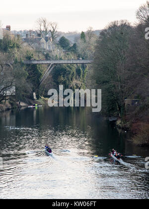Durham, England, UK - January 29, 2017: University rowing crews train on the River Wear below the modernist concrete - Stock Photo