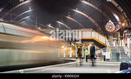 York, England, UK - January 29, 2017: Passengers at York railway station await the departure of a Virgin Trains - Stock Photo