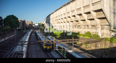 London, England, UK - May 25, 2017: A fleet of London Midland Class 350 commuter trains pass Rowley Way, a unique - Stock Photo