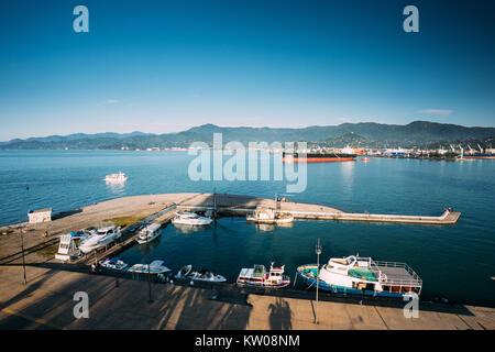 Batumi, Adjara, Georgia - May 25, 2016: Aerial View Of Port Dock On Sunny Evening At Sunset Or Sunrise Time. Sunny - Stock Photo