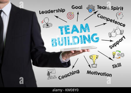 team building concept.  Chart with keywords and icons. Man holding a tablet computer - Stock Photo