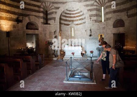 The Sword of San Galgano in Eremo di Montesiepi (Montesiepi Chapel) on the top of the hill where XII century knight - Stock Photo