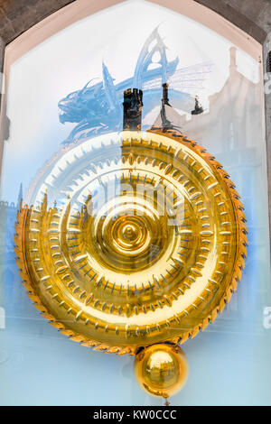 The chronophage clock, designed by John Taylor, behind a window on a wall at Corpus Christi college, university - Stock Photo