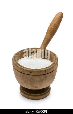 natural salt into wooden pestle, on white background - Stock Photo