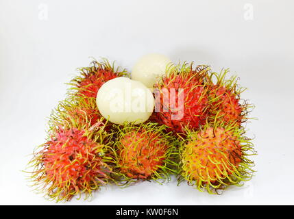 rambutan tropical fruit peel out on white background - Stock Photo
