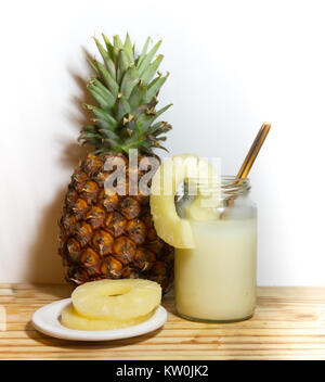 glasses with juice pineapple drinks and smoothies fresh pineapple - Stock Photo