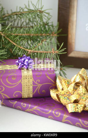 Beautifully wrapped Christmas gifts and presents in ultra violet. Colorful gift boxes on a white styled background - Stock Photo