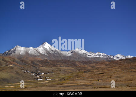A beautiful view of Langza village nestled in the shadow of the mighty Princess Mountain (Chau Chau Kang Nilda) - Stock Photo