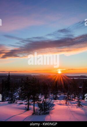 Winter sunrise in Finland - Stock Photo