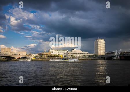 Heavy clouds over London Southbank with the River Thames, Shell Centre Tower, Royal Festival Hall & Waterloo Bridge. - Stock Photo
