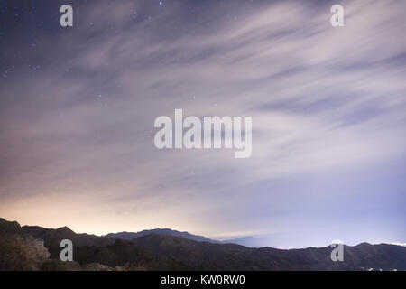 Desert Night Sky with beautiful colors throughout the sky. Lookout spot overlooking Palm Springs with stars beyond - Stock Photo
