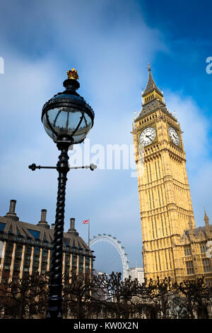 St Stephen's Tower or Big Ben and the Palace of Westminster in London, England, UK. Portculis house can be seen - Stock Photo
