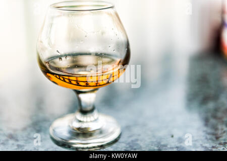 Macro closeup of amaretto, rum, or bourbon drink in glass - Stock Photo