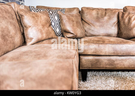 Elegant modern room closeup of leather couch and fluffy rug in staging model house, home or apartment - Stock Photo