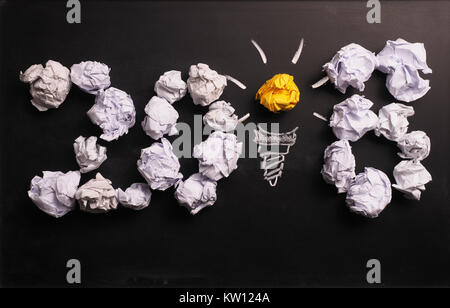 Crumpled paper on a chalkboard with the number 2018, New Years creativity concept - Stock Photo