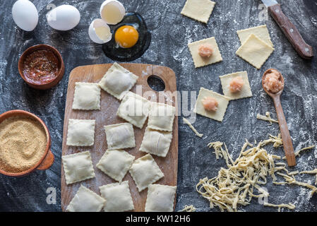Ingredients for cooking ravioli on the wooden board - Stock Photo