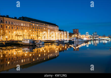 Helsinki, Finland. View Of Pier With Boats And Pohjoisranta Street In Evening Night Illuminations. - Stock Photo