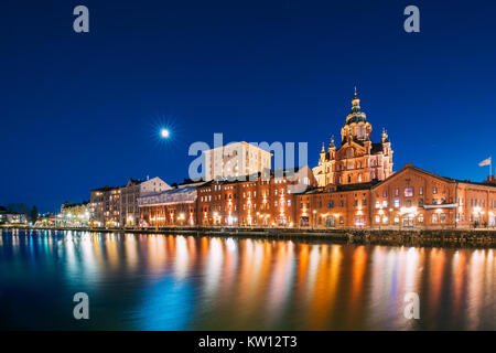 Helsinki, Finland. View Of Kanavaranta Street With Uspenski Cathedral In Evening Night Illuminations. - Stock Photo