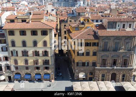 Italy, Florence - May 18 2017: the view from Palazzo Vecchio on Palazzo Uguccioni in the Piazza della Signoria on - Stock Photo