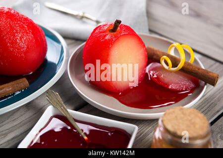 Poached pears in spiced red wine. wooden background - Stock Photo